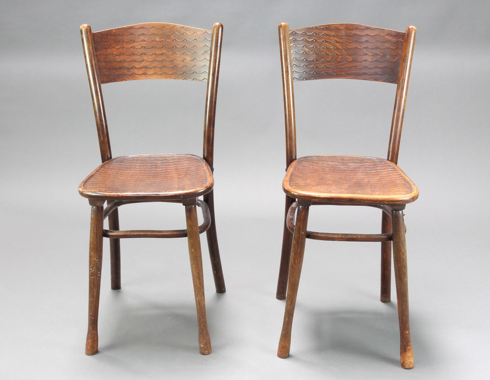 Jacob & Josef Kohn Wien, a pair of bentwood chairs both with labels to base One leg is a/f and has