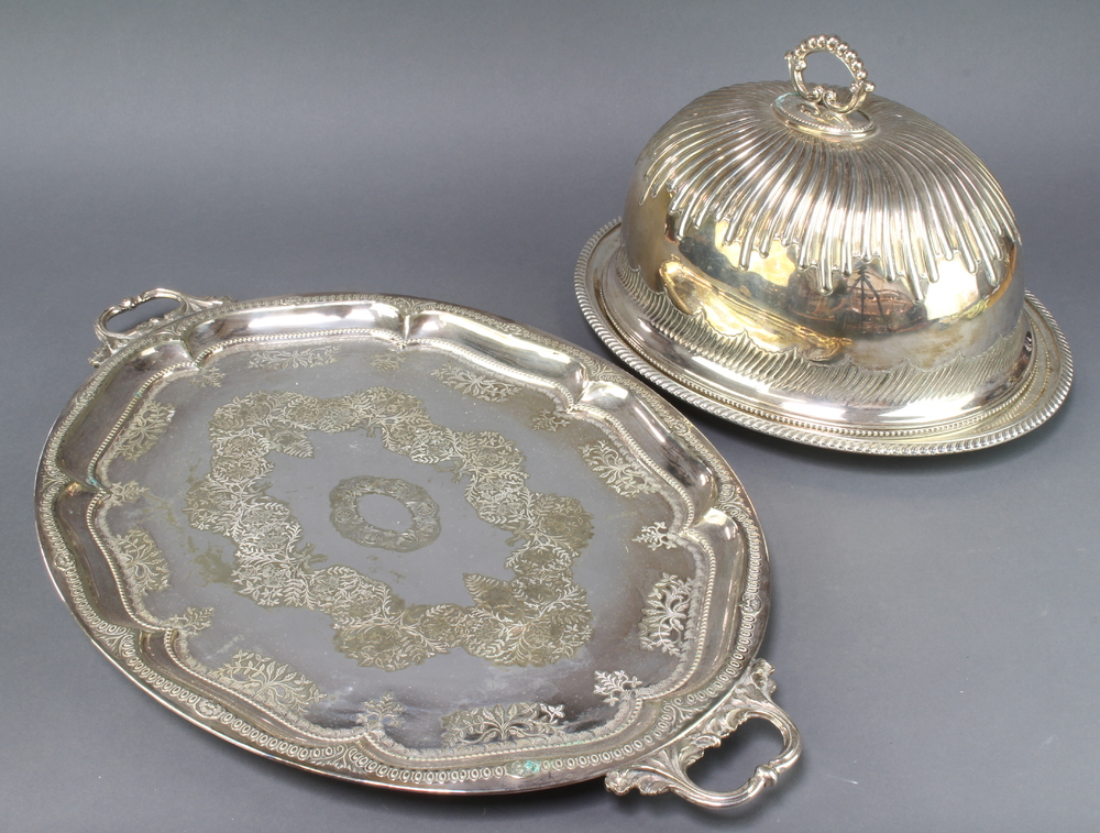 An Edwardian silver plated 2 handled tray 65cm, an oval meat dish and a meat cover