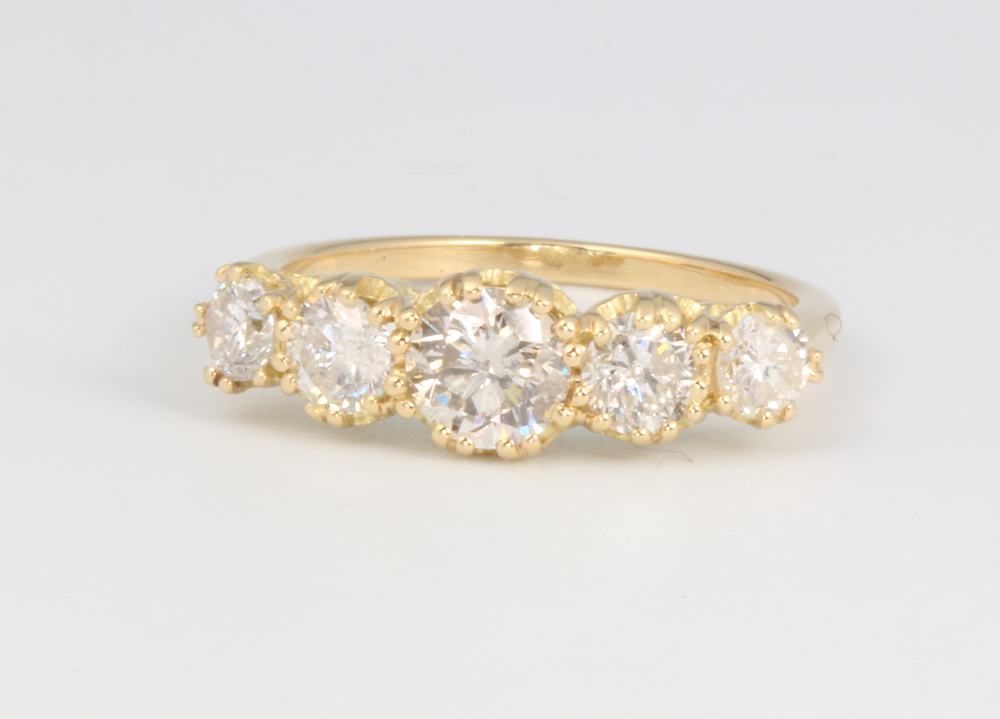 An 18ct yellow gold 5 stone graduated diamond ring approx. 1.59ct, 2.9 grams, size L 1/2