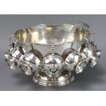 A plated pedestal punch bowl, ladle and 8 cups