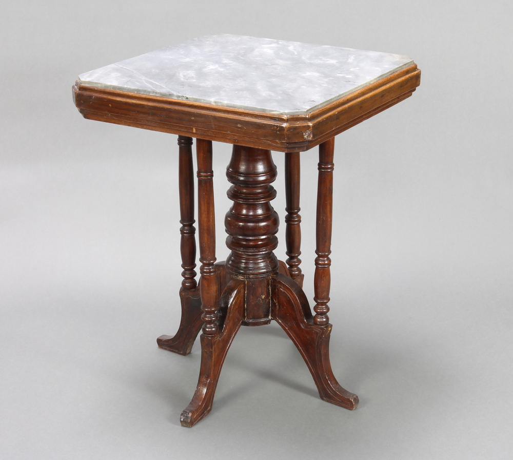 A Victorian octagonal grey marble and mahogany pedestal centre table, raised on turned column