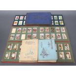 Twelve albums of cigarette cards including Wills (x2), Ogdens, Players (x8) and Gallaghers