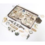 A quantity of mother of pearl mounted jewellery including brooches, pins, watches, clips etc