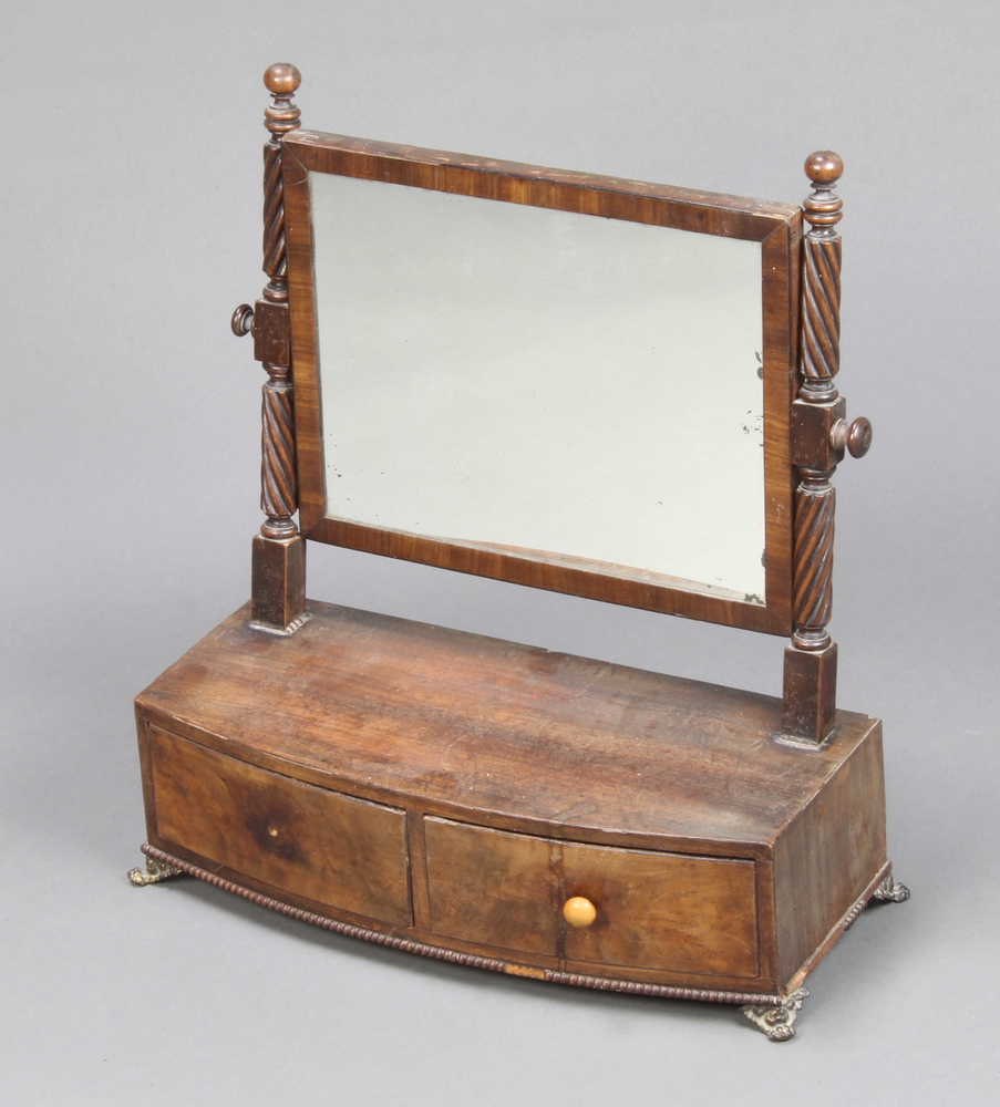 A William IV rectangular plate dressing table mirror contained in a mahogany frame on spiral
