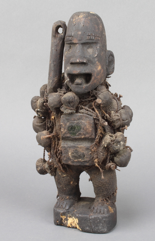 """A """"Voodoo"""" carved figure of a standing man 30cm x 9cm x 6cm Signs of old but treated worm"""