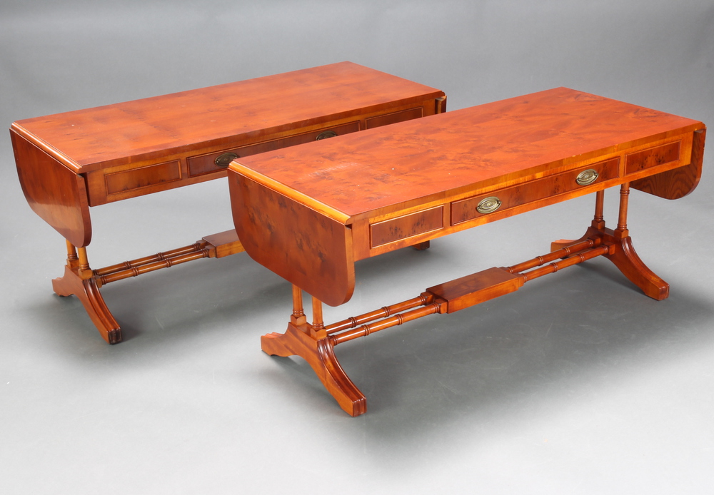 A pair of Georgian style miniature crossbanded yew sofa tables fitted a drawer, raised on turned