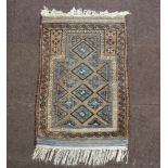 A brown and blue ground Persian prayer rug 110cm x 72cm