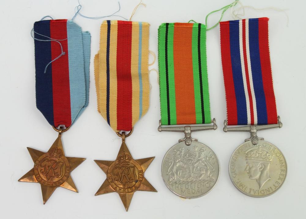 A 1939-45 Africa Star, War medal and Defence medal
