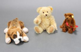A brown Steiff bear with articulated limbs and bronze badge marked Worlds First Bear 24cm, a