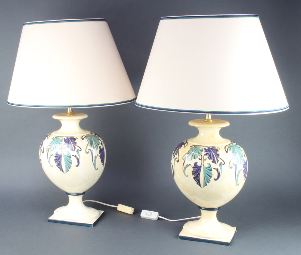 A pair of Continental pottery table lamps in the form of urns, raised on square bases 38cm x 17cm