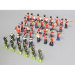 A collection of Britains, Fylde and other lead figures: Guardsmen & Highlanders