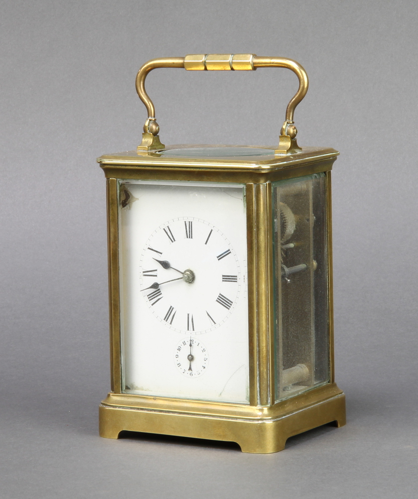 A French 8 day carriage alarm clock with enamelled dial, Roman numerals and alarm dial, contained in