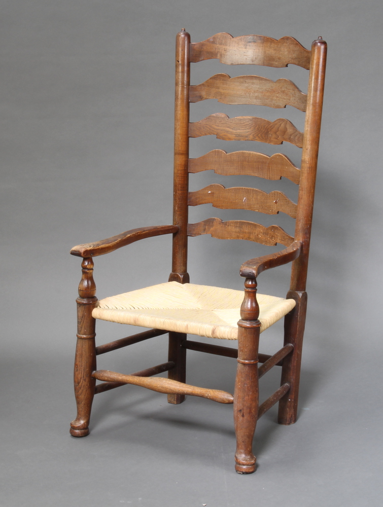 A 18th Century elm Lancashire ladder back chair with woven rush seatSome sun bleaching and signs
