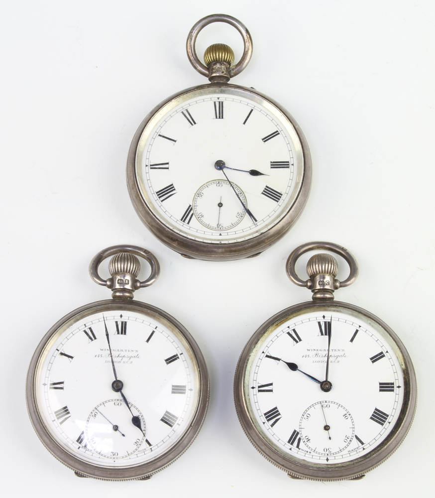 Three keyless open faced pocket watches contained in silver cases On one watch the crystal is F