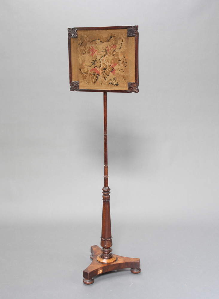 A William IV rosewood pole screen with square Berlin woolwork banner raised on a turned column