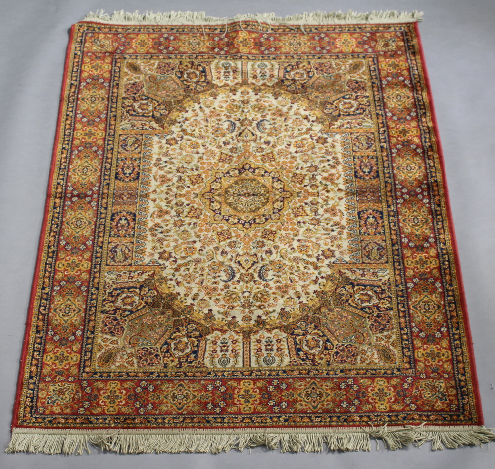 A brown ground Persian style machine made rug with central medallion 167cm x 124cm