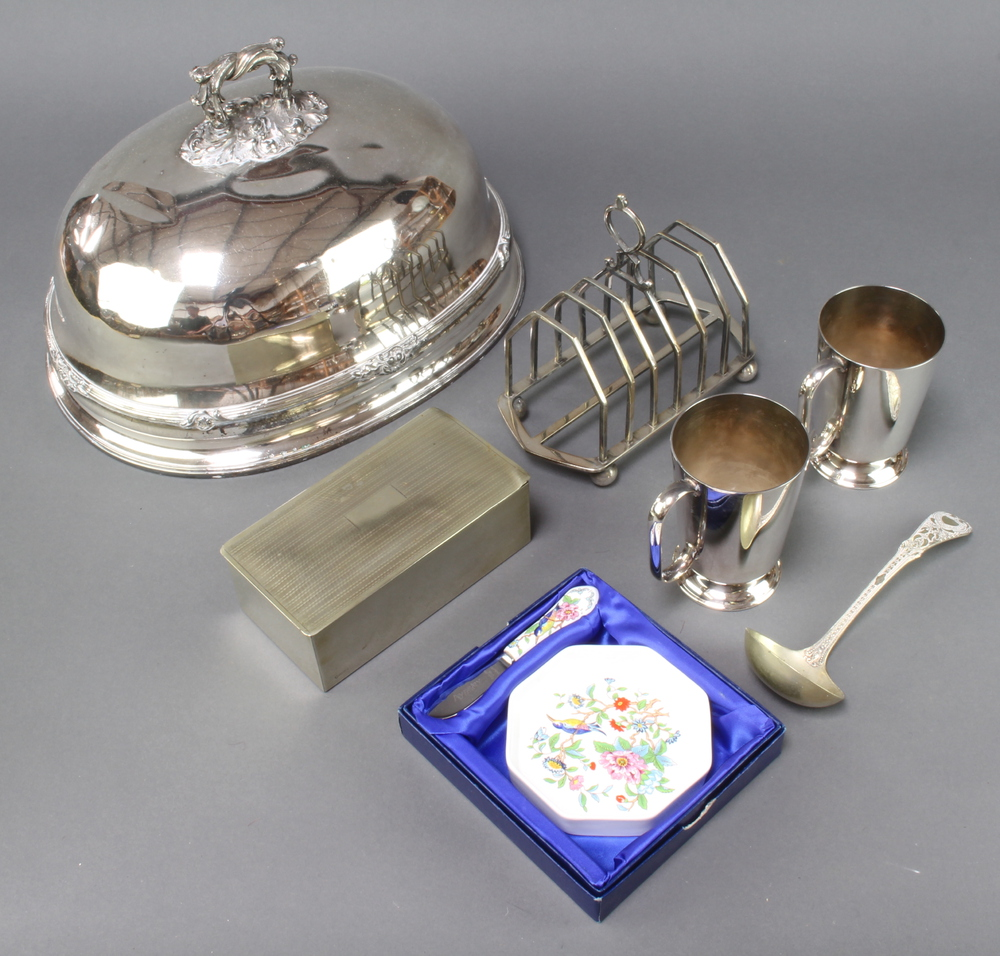 An Edwardian silver plated meat cover with chased armorial 34cm together with minor plated