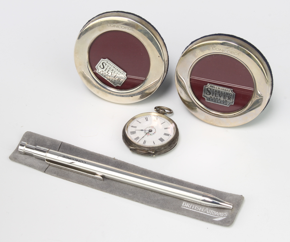 A pair of sterling silver circular Concorde photograph frames 6.5cm diam., a pen and fob watch