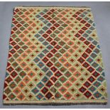 A yellow, blue and green ground Chobi Kilim rug with all over geometric design 155cm x 105cm