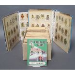 Two albums of silk cigarette cards and a shallow box containing a collection of Players cigarette