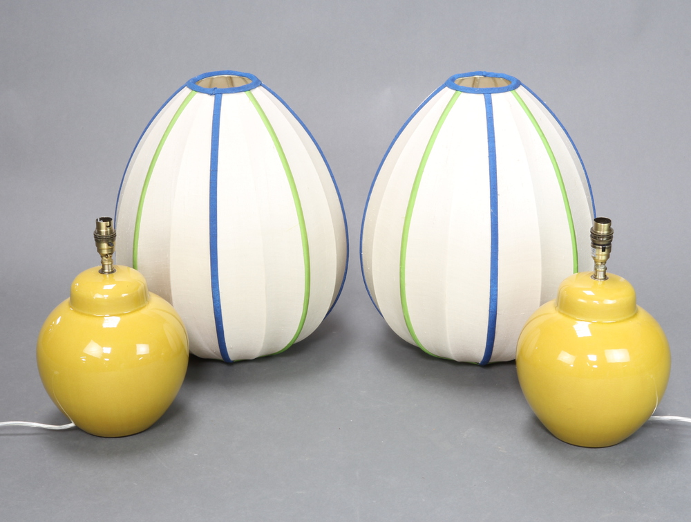 A pair of Celadon green ground table lamps in the form of ginger jars and covers 25cm x 17cm