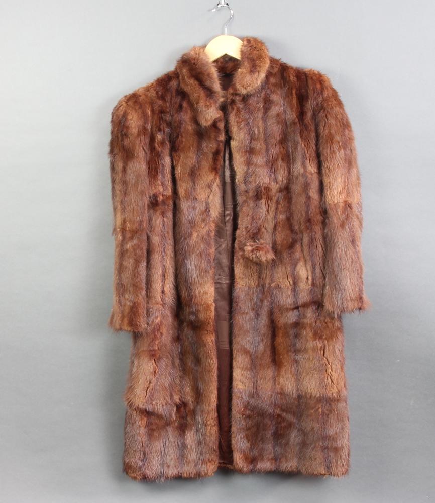 A lady's full length mink coat (some molt)