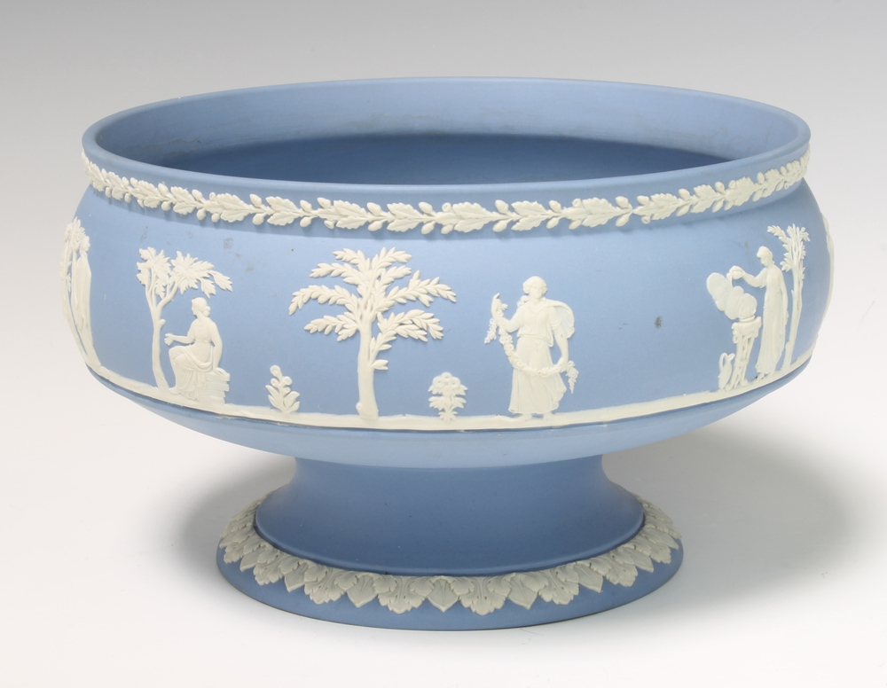 A Wedgwood blue Jasperware pedestal bowl decorated with figures before trees 22cm