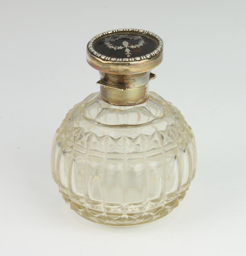A silver tortoiseshell piquet mounted cut glass scent bottle Birmingham 1921 10cm