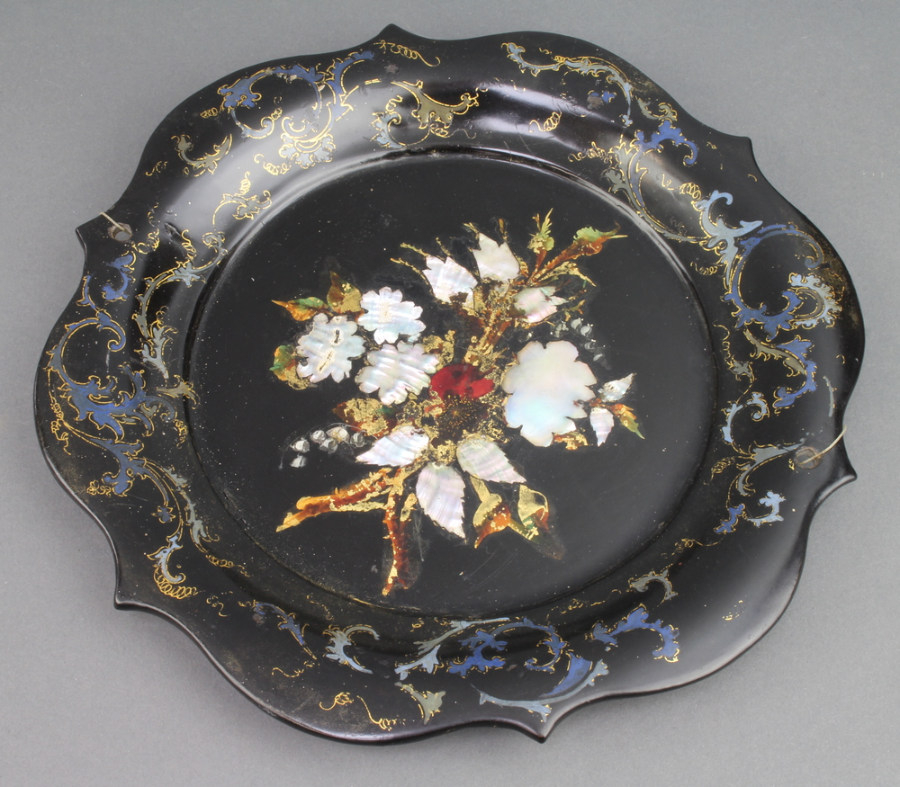 A Victorian circular floral papier mache dish 24cm There are two small holes to the side where