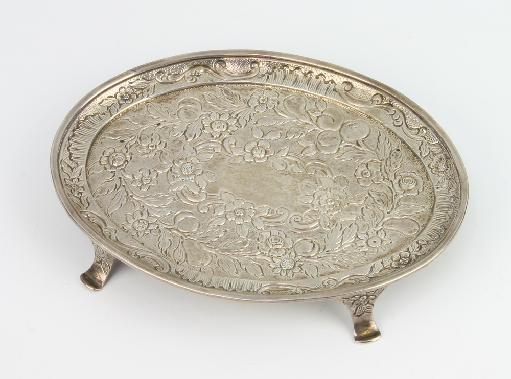 A William IV silver oval stand profusely decorated with flowers on scroll feet, 16cm, 140 grams