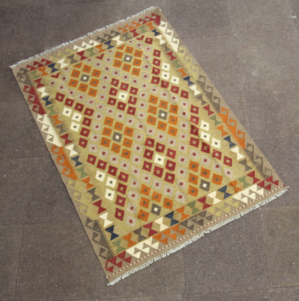 A tan, brown and white ground Maimana Kilim with all over geometric design to the centre within a
