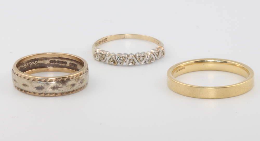 An 18ct yellow gold wedding band, size T, 4 grams a 9ct ditto, size N, 3 grams and a 9ct gold