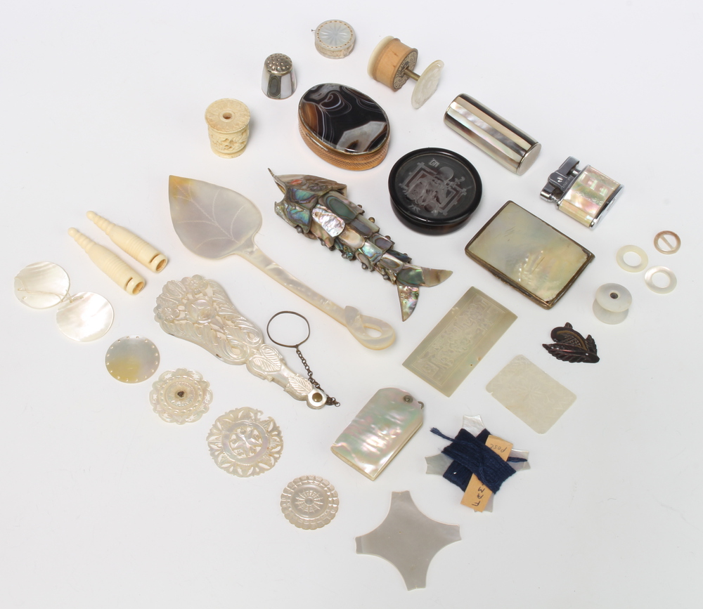 A mother of pearl mounted aide memoire, an articulated fish and minor items