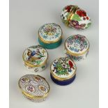 A Halcyon Days enamelled egg decorated with fruits 6cm, 4 ditto pill boxes and a Bilston and