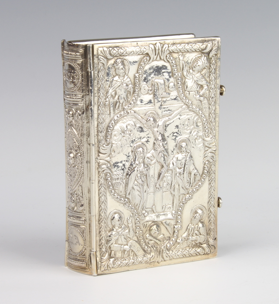 A Continental silver repousse bible cover decorated with biblical scenes 210 grams, 10.5cm