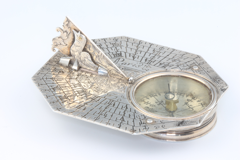A rare silver pocket sundial and compass by Michael Butterfield, Paris, circa 1700 contained in an