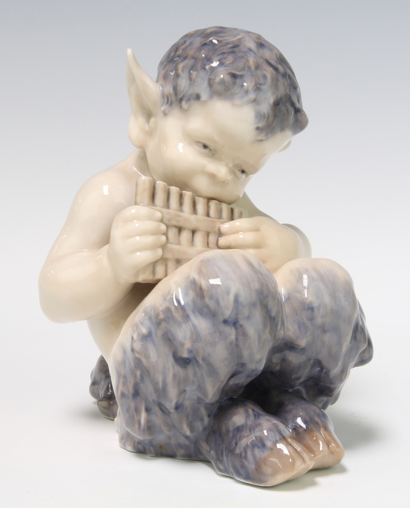 A Royal Copenhagen figure of Pan playing his pipes 15cm