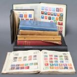 An album of GB mint stamps Edward VIII to Elizabeth II, a red Standard album of used world stamps