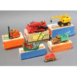 Dinky, a 561 Supertoys Blaw Knox Bulldozer in red with buff box and red label, a 25x Breakdown Lorry