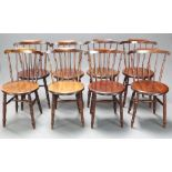 A set of 8 19th Century beech framed Windsor stick and rail back dining chairs, raised on ring