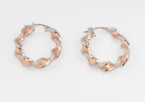 A pair of 2 colour 9ct gold twist hoop earrings 3.5 grams