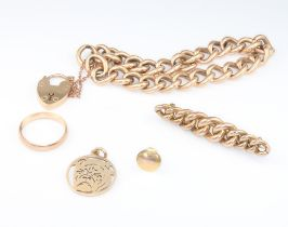 A 9ct yellow gold bracelet and padlock, a ditto stud and ring, 17.5 grams and a yellow metal brooch