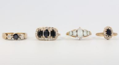 Four 9ct yellow gold gem set rings, 9.5 grams, sizes G, L, L and M