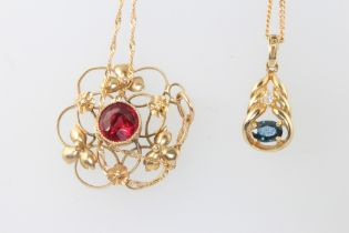 Two 9ct yellow gold chains with garnet and sapphire set pendants, 6.5 grams gross