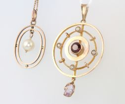 A 9ct yellow gold pendant on a yellow metal chain and a 9ct yellow gold pendant 5 grams