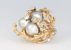 A vintage yellow metal grey baroque pearl and diamond ring, diamonds 0.5ct, 17.3 grams, size N