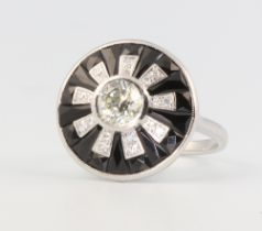 An 18ct white gold Art Deco style diamond and onyx target ring, the centre stone approx. 0.7ct, size
