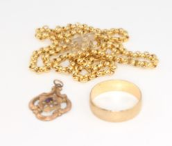 A 9ct yellow gold wedding band and a 9ct yellow gold pendant 3.6 grams together with a yellow