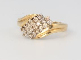 An 18ct yellow gold crossover diamond ring, size M 1/2, 4.3 grams