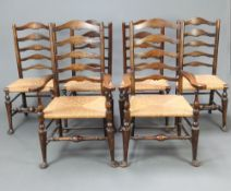 A set of 6 17th Century style beech and elm ladder back dining chairs with woven rush seats